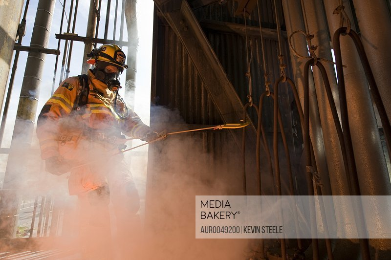 Firefighter Alan Baker practices fire escape and Industrial Search and Rescue at an abandoned oil refinery in Santa Fe Springs, California on March 11, 2008.