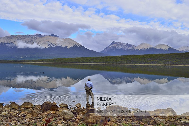 Man fly fishing in Tres Valles Lake, Argentina