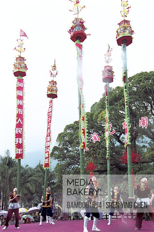 Performers balancing pole in festival, Winter jasmine folk art performance in country forest park, Fuzhou City, Fujian Province of People's Republic of China