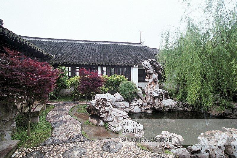 Fountain by house, Jingsi garden of Jiaozhi region of rivers and lakes pond, Jiaozhi Town, Kunshan City, Jiangsu Province of People's Republic of China