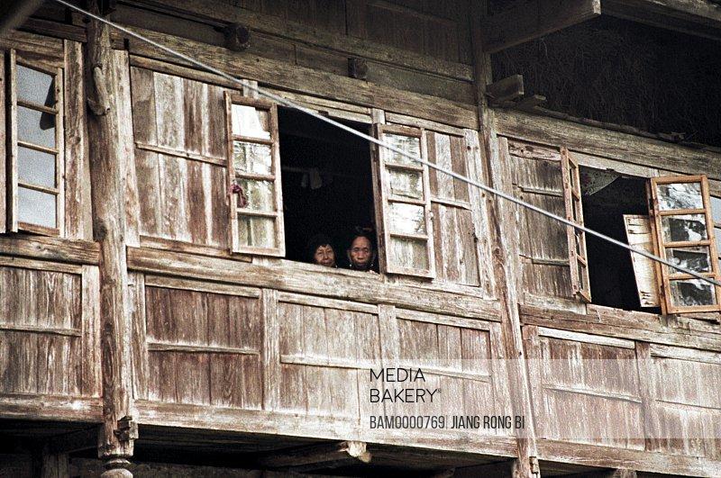 People looking from window, The Yao minority people in Longji mountain, Longsheng County, Guilin City, Guangxi Zhuang Nationality Autonomous Region of People's Republic of China