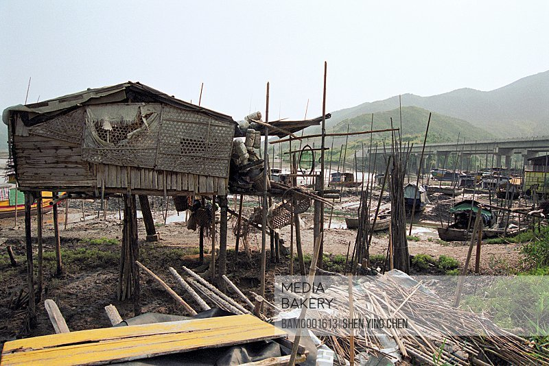 Construction site with bridge in the background, The houseboat of Yiantian Village, Yantian, Xiaopu County, Fujian Province of the People's Republic of China