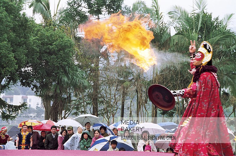 Person in traditional costume performing on stage, Winter jasmine folk art performance in country forest park---Turning hostile, Fuzhou City, Fujian Province of People's Republic of China