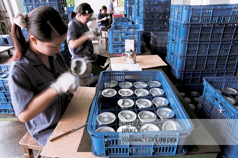 Female worker of piston workshop, Fuxing investment district, Fuzhou City, Fujian Province of People's Republic of China