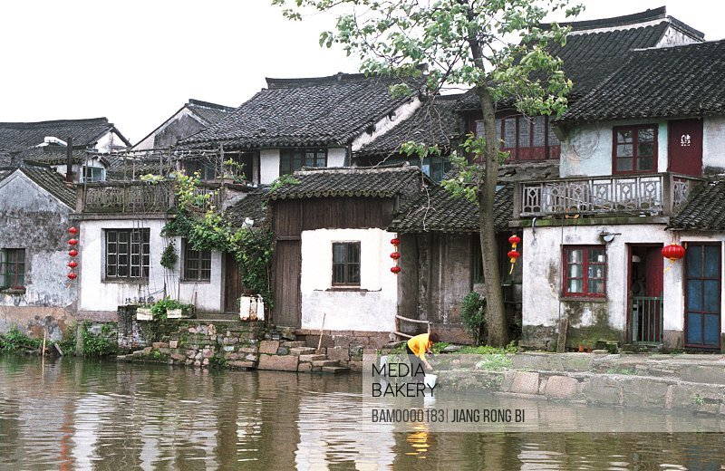View of a person with bucket by river, Ancient Residence in Xitang Town, Jiaxing City, Zhejiang Province, People's Republic of China