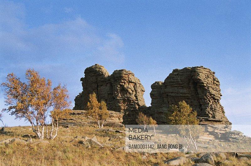 Low angle view of rocks against sky, The Asihatu Hoodoo of World geology park, Keshiketengqi, Chifeng City Inner Mongolia Autonomous Region of People's Republic of China