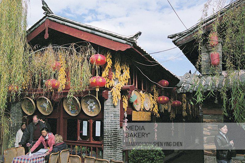 People at a restaurant decorated with Chinese lanterns, Historic building of old Lijiang city, Lijiang old city, Yunnan Province of People's Republic of China