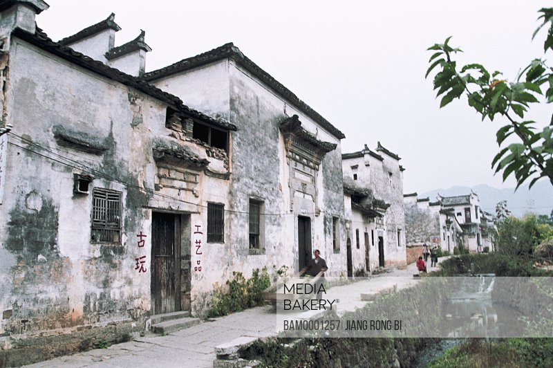 View of people walking near houses, Flagstone Road beside Streamlet in Ancient Pingshan Village , Yixian County, Anhui Province, PRC