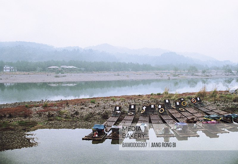 Bamboo rafts lying on sand by river, Nanxi River, Yongjia County, Zhejiang Province, People's Republic of China