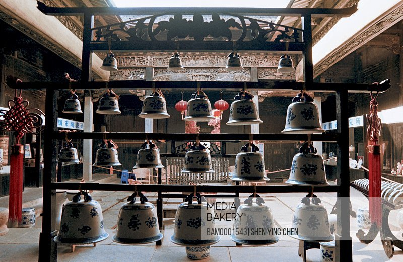 View of bells arranged on stand, Ceramic demonstration, Ancient kiln museum, Jingde town, Jiangxi Province of People's Republic of China
