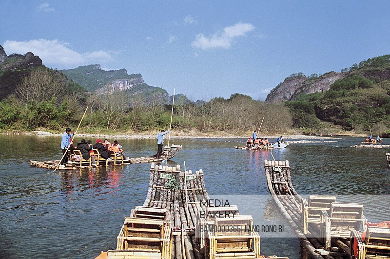 People traveling on bamboo rafts in the river, Bamboo Raft on Jiuqu River of Mount Wuyi, Wuyishan City, Fujian Province, People's Republic of China
