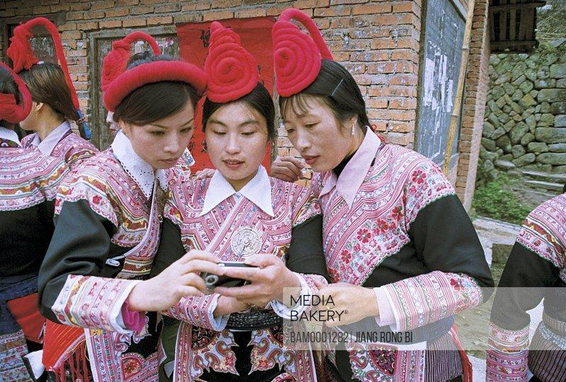 Young women watching digital photos, She Nationality Ladies Watching Digital Photos , Huokou Township, Luoyuan County, Fuzhou City, Fujian Province, PRC