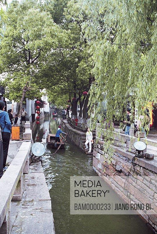 People walking by canal, The scenery of bridge of Jiaozhi region of rivers and lakes pond, Jiaozhi Town, Kunshan City, Jiangsu Province of People's Republic of China