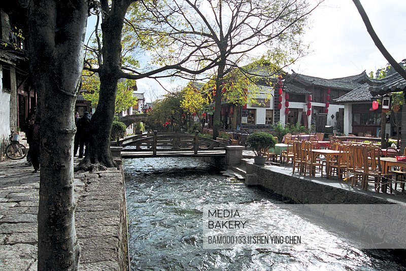 Water flowing under a bridge, Historic building of old Lijiang city, Lijiang old city, Yunnan Province of People's Republic of China