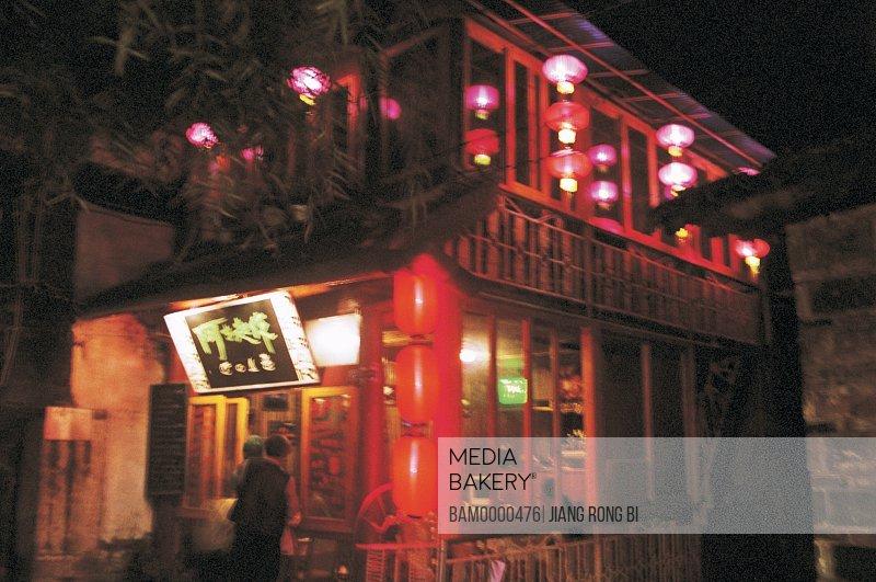 Cafe at decorated illuminated Chinese lanterns, Lijiang Ancient Streets, Lijiang City, Yunnan Province, People's Republic of China
