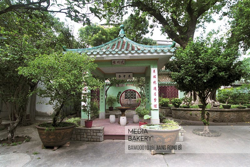 View of The Yuezhong Pavilion with trees and potted plants, Macao Park, Macao special administration region of People's Republic of China