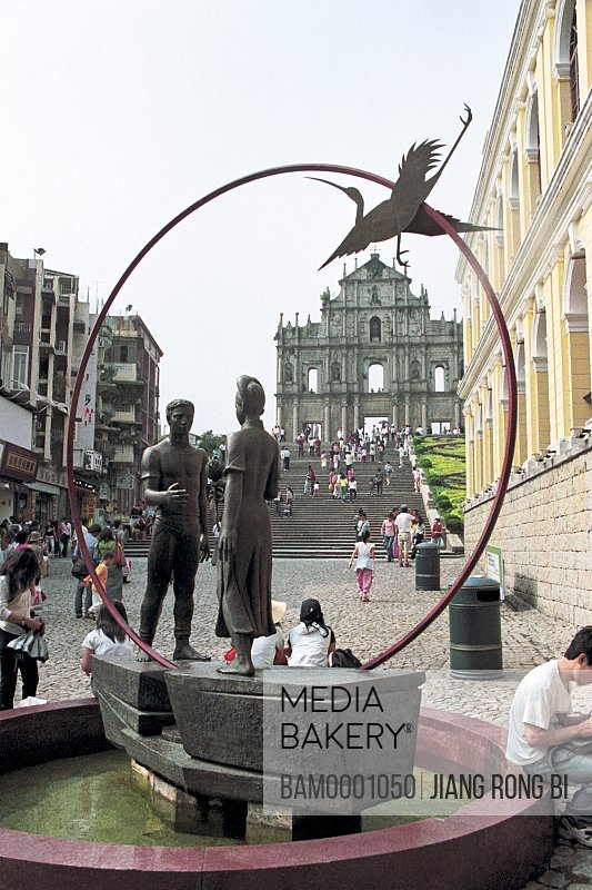 View of statues with ancient structure in the background, The Square in front of Ruins of St. Paul, Macao special administration region of People's Republic of China