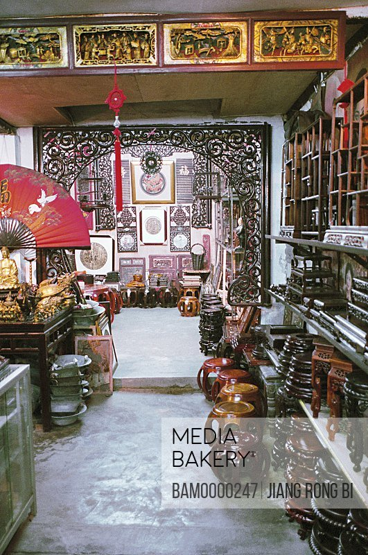 Interior of a souvenir shop, The shop of old wooden sculpture of Zhouzhuang region of rivers and lakes pond, Zhouzhuang Town, Kunshan City, Jiangsu Province, People's Republic of China