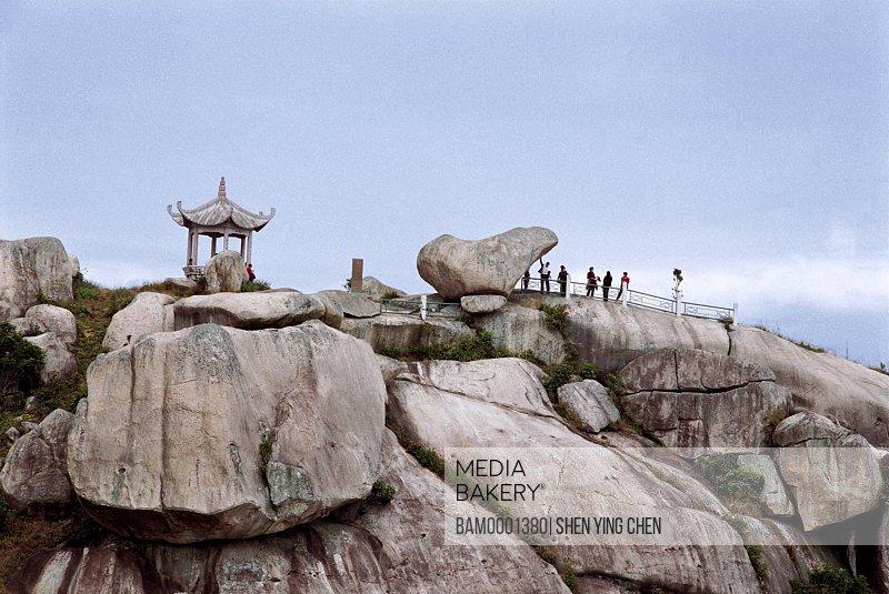 View of tourists standing on rocks, Scenery on Sanduao island , Sanduao, Ningde County, Fujian Province of People's Republic of China