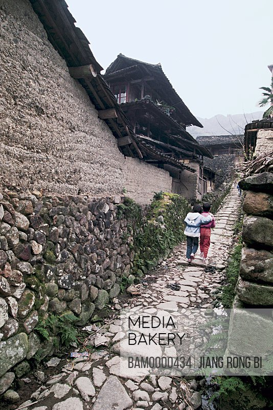 View of children walking on pathway by house, Pupils Returning after School, Taishun County, Zhejiang Province, People's Republic of China