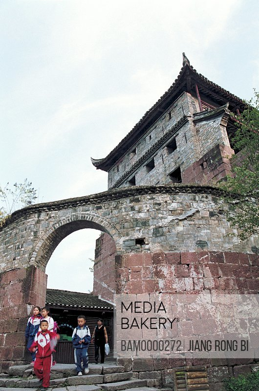 Children walking by wall of ancient structure, The old wall of Fenghuang ancient city, Fenghuang, Xiangxi Prefecture, Hunan Province, People's Republic of China