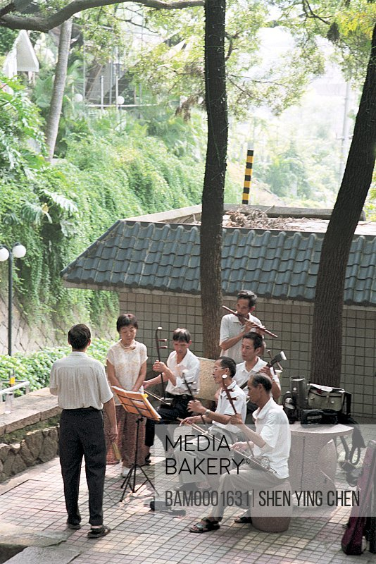 Group of musicians playing musical instruments, The folk entertainer is performing in the Yushan scenic area, Yushan, Fuzhou City, Fujian Province of People's Republic of China