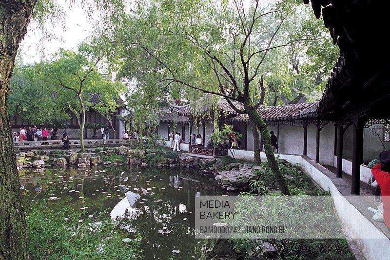 Tourists walking on round porch by lake, The round porch of Zhuozheng park, Suzhou City, Jiangsu Province, People's Republic of China