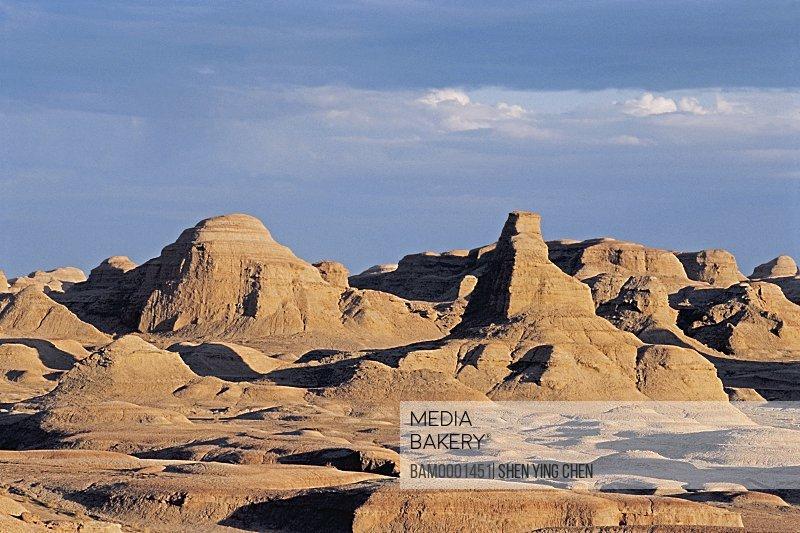 Landscape against cloudy sky, Yadon landform of evil spirit ghost town in Uerhe, Kelamayi County, Xinjiang Uygur Autonomous Region of People's Republic of China