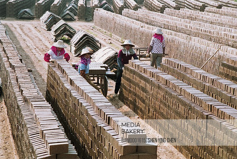 Elevated view of workers working on construction site, The Huian Women in the brickyard of the Huian County, Huian County, Fujian Province of People's Republic of China