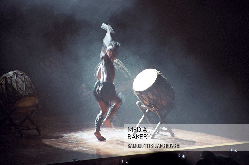 View of a man banging drum on stage, The folk custom acting in the Qingyun mountain, Changle, Fuzhou City, Fujian Province, People's Republic of China