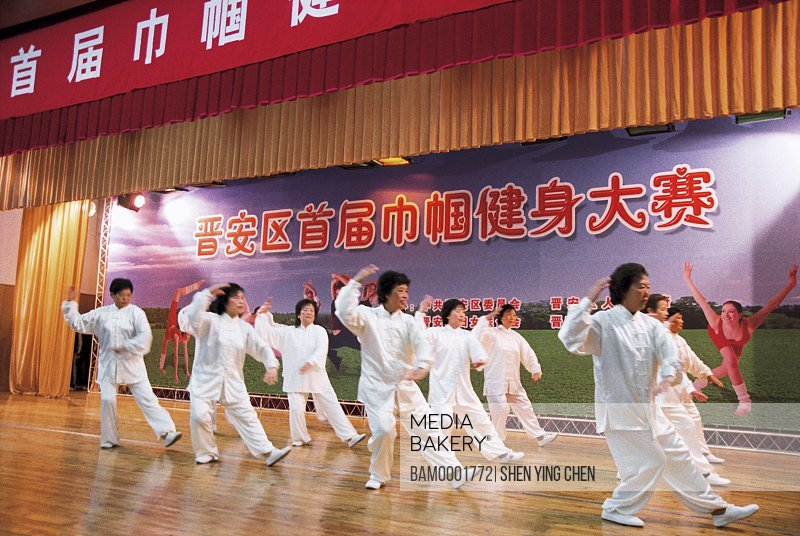 Women performing on stage, First session woman's big game Taijiquan performance in Jinanl area, Jinan District, Fuzhou City, Fujian Province of People's Republic of China
