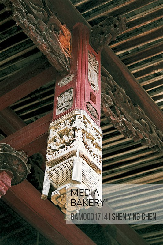 Low angle view of artistic pillar hanging on wooden beam, The carving and imperial decree in Great Lin places, Great Honglin Places, Mingqing County, Fujian Province of People's Republic of China