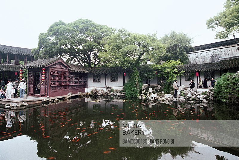 View of tourists by Stupas, The scenery of Tuisi Garden in Tongli region of rivers and lakes pond, Tongli Town, Wujiang City, Jiangsu Province of People's Republic of China