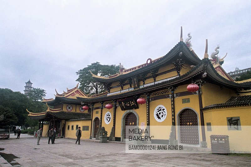 Tourists standing in front of a temple, Jiangxin Temple on Jiangxin Islet, Wenzhou City, Zhejiang Province, People's Republic of China