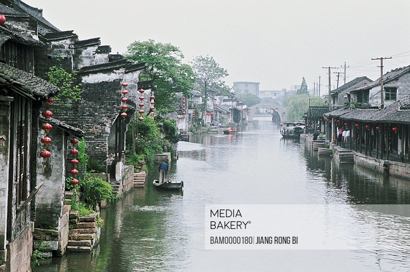 Houses with Chinese lanterns by river, Xitang Town's Ancient Residence near Water, Jiaxing City, Zhejiang Province, People's Republic of China