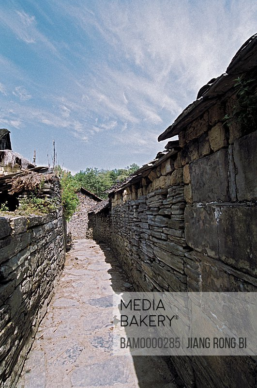 Narrow passage between TheStronghold wall in Guzhai of Shujiatang, Fenghuang, Xiangxi Prefecture, Hunan Province, People's Republic of China