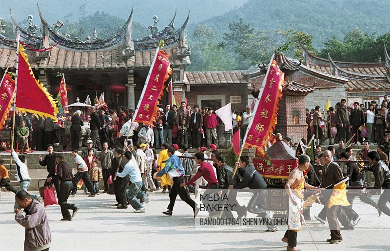 Men carrying palanquin in fair, Mountain temple fair performance of Beichen---Meeting the god, Beichen Mountain, Tongan County, Fujian Province of People's Republic of China