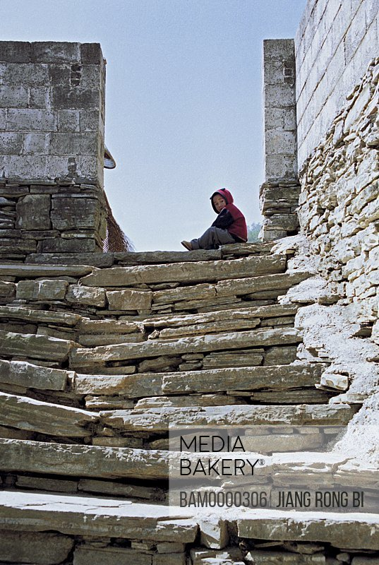 Low angle view of a stone steps leading to a boy, The green rock flight of steps in Shibanzhai of Fenghuang ancient city, Fenghuang, Xiangxi Prefecture, Hunan Province, People's Republic of China