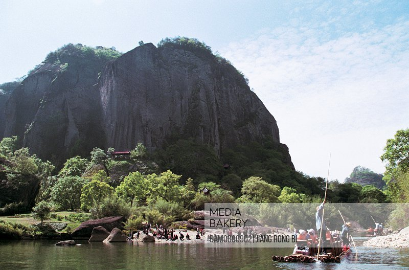 Tourist rafting on river with Shaibu Rock in the background, Scenery of Shaibu Rock , Wuyishan City, Fujian Province, People's Republic of China