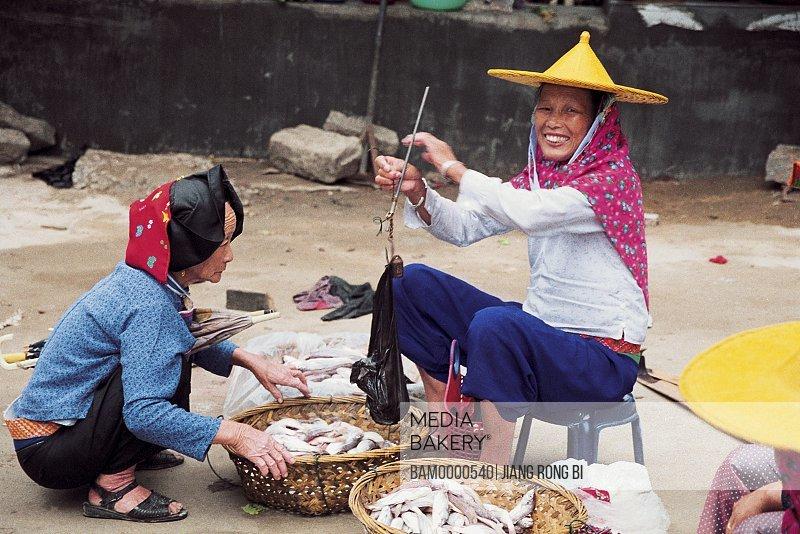 Huian Ladies Selling Fish in Xiaozuo Village, Chongwu Town, Huian County, Fujian Province, People's Republic of China
