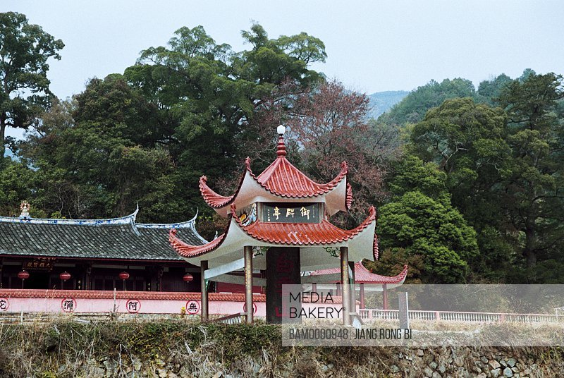View of a structure with trees in the background, Yubei (Imperial Stele) Pavilion in Baiyun Village of Baizhang Town, Minqing County, Fuzhou City, Fujian Province, People's Republic of China