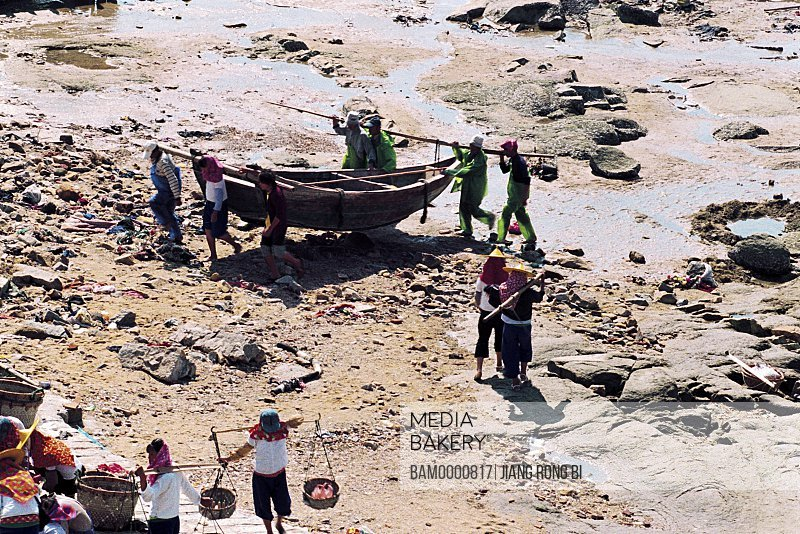 Elevated view of people working at a seashore, Fish Boat Returning to Dock of Xiaozuo Village, Chongwu Town, Huian County, Fujian Province, People's Republic of China