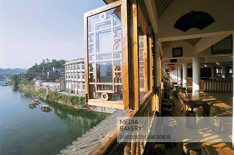 View of river from cafe window, Linjiang Tea building in the old city, Fenghuang, Xiangxi Prefecture, Hunan Province, People's Republic of China