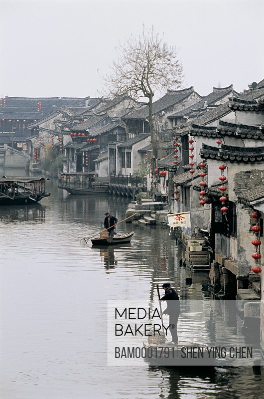 Aquatic sanitation engineer on the water of old old Xitan Town, Jiaxing city of Zhejiang province in People'c republic of China