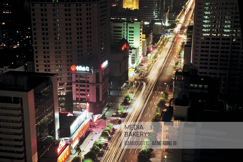 Elevated view of road amid buildings, Night scenery of Wuyi road, Fuzhou City, Fujian Province, People's Republic of China