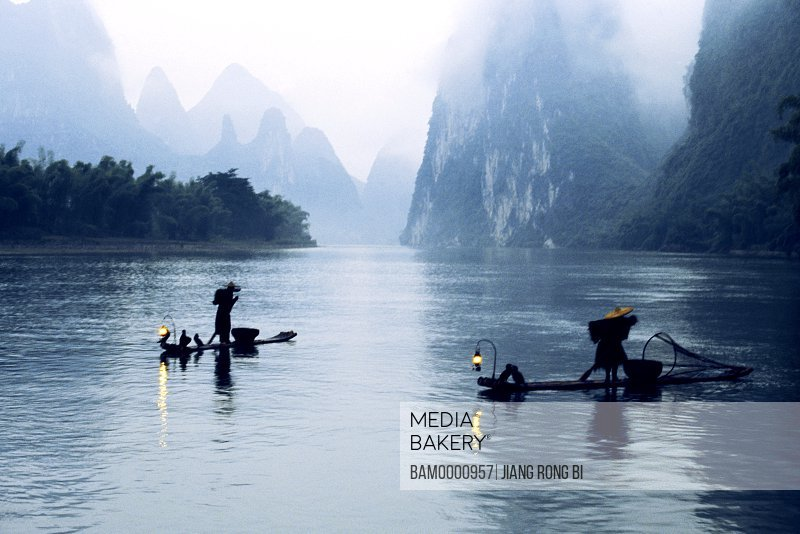 View of people fishing on Li river, Yangshuo County, Guilin City, Guangxi Zhuang Nationality Autonomous Region of People's Republic of China