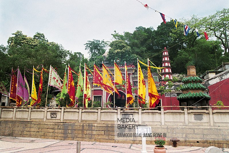Flags with temple in the background, Mage Temple in Macao, Macao special administration region of People's Republic of China