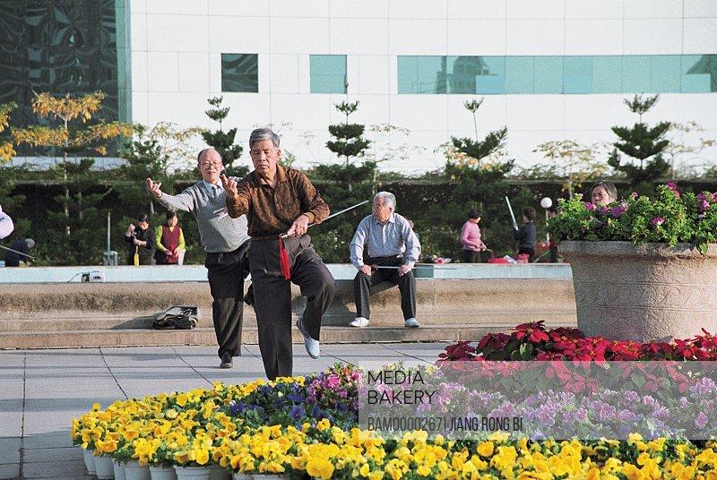 Senior men exercising in park, People doing morning exercises in Wenquan park, Fuzhou City, Fujian Province, People's Republic of China