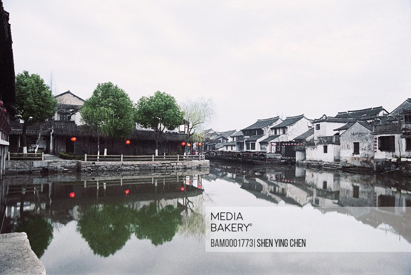 View of roofed houses by lake, Ming and Qing dynasty historic building of old Xitan Town, Jiaxing city of Zhejiang province in People'c republic of China