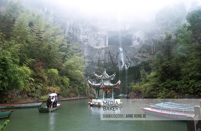 View of a structure in lake with waterfall in background, Nanxi River Longpu Cave , Nanxi River, Yongjia County, Zhejiang Province, People's Republic of China